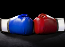 boxing gloves or martial arts gear on a black background